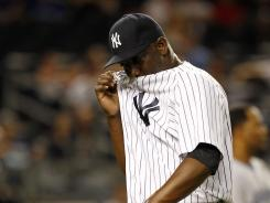 Rafael Soriano reacts after giving up a three-run home run to Colby Rasmus in the ninth inning.