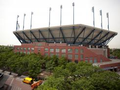 """Arthur Ashe Stadium will have a roof someday, the USTA says. """"We're getting close,"""" says Gordon Smith, the USTA's chief operating officer."""