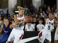 The USA's Ann Strother, center, looks for space as France's Le Leuch Perrine, left, defends and U.S. teammate Skylar Diggins calls for the ball during the 3-on-3 World Basketball Championship title game.