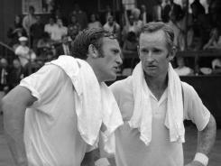 Rod Laver, right, and Tony Roche following the 1969 U.S. Open final at Forest Hills.