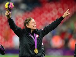 U.S. forward Abby Wambach celebrates following the Americans' game against Japan during the London Olympics at Wembley Stadium. The USA won 2-1 to earn the gold medal.