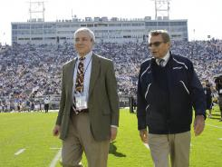 Penn State on Saturday plays its first football game since the death of longtime coach Joe Paterno, shown here in October 2011 with former Penn State president Graham Spanier. Both men drew heavy criticism in a report by former FBI Director Louis Freeh for their role in the handling of early reports that assistant football coach Jerry Sandusky had sexual contact with children.