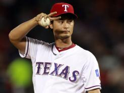 Rangers starter Yu Darvish signals to the catcher during Tuesday's 2-1 Texas win vs. the Rays.