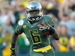 """I'm just trying to contribute,"" says Oregon running back De'Anthony Thomas, scoring on a 64-yard run Jan. 2."