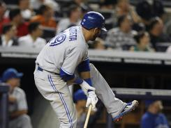 Blue Jays slugger Jose Bautista holds his wrist after a swing July 16 vs. the Yankees.