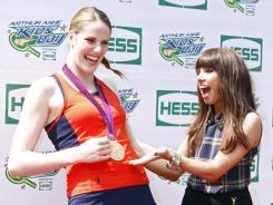 Missy Franklin and Carly Rae Jepsen laugh it up at the Arthur Ashe Kids' Day. Franklin starred in the U.S. Olympic swimming team's rendition of Call Me Maybe.