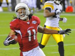 Cardinals wide receiver Larry Fitzgerald (11) celebrates after catching a pass for a touchdown during the fourth quarter of Super Bowl XLIII, but the Steelers came back to win the game in the closing seconds.