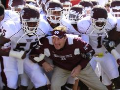 Coach Dan Mullen and the Mississippi State football team last season before a game.