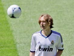 New Real Madrid player Luka Modric from Croatia plays with the ball before a press conference during his official presentation in Madrid.