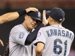 No support necessary: Mariners teammates congratulate Felix Hernandez, left, Monday after he beat the Twins 1-0 — his fourth win by that score this season and third in August.