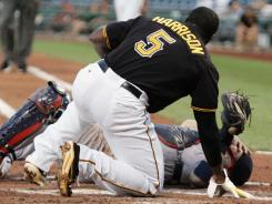 Pirates second baseman Josh Harrison, foreground, collides with Cardinals catcher Yadier Molina during Tuesday's 9-0 Pittsburgh win. Molina left the game and was listed as day-to-day.