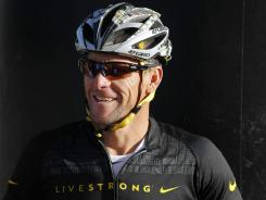 Lance Armstrong jokes with fellow riders as they wait for the start of the Power of Four mountain bicycle race at the starting line in Snowmass Village, Colo., on Saturday. The race was the first public appearance for Armstrong since the U.S. Anti-Doping Association stripped him of his seven Tour de France championships and banned him for life from the sport.