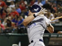 Rays DH Evan Longoria hits a solo home run in the ninth Wednesday vs. the Rangers.