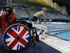 A British swimmer trains in the Aquatic Center during a swimming training session ahead of the Paralympics on Wednesday in London.