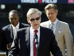 Commissioner Bud Selig announces that the Twins will host the 2014 All-Star game at Target Field prior to Wednesday's game between the Twins and Mariners. At the rear are former Twins greats Rod Carew, left, and Roy Smalley.