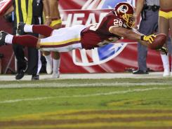 Roy Helu Jr. dives into the end zone to complete his 15-yard touchdown run.
