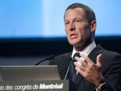 Lance Armstrong told delegates at the World Cancer Congress in Montreal on Thursday that he 'refuses to be distracted' from his work for the Livestrong foundation in the wake of the U.S. Anti-Doping Agency stripping of his cycling results since 1998 and banning him from competition for life.