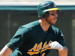 Athletics' George Kottaras hits a three RBI double in the fourth inning to break a 1-1 tie vs. the Indians.