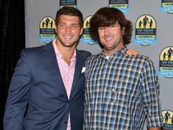 Tim Tebow and Bubba Watson attend the Tim Tebow Foundation Celebrity Golf Classic Gala at TPC Sawgrass on April 13 in Ponte Vedra Beach, Fla.