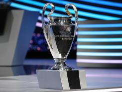 The UEFA Champions League trophy on display during the group stage draw on Thursday in Monaco.