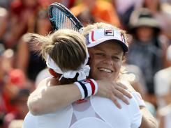 Kim Clijsters and Kirsten Flipkens of Belgium embrace after losing to Chia-Jung Chuang and Shuai Zhang in doubles on Wednesday.