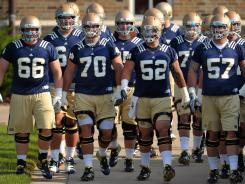 "Off the air: Notre Dame will walk onto the field Saturday in Dublin to face Navy with four players on suspension. Radio broadcaster Allen Pinkett was sent to the sideline, too, after suggesting a few ""bad citizens"" could be beneficial."