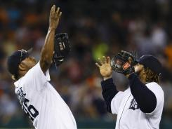 Closer Jose Valverde and first baseman Prince Fielder celebrate the Tigers' win Friday vs. the White Sox.