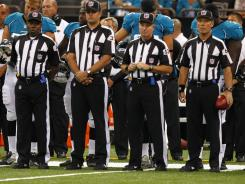 NFL replacement officials, shown here before a recent exhibition game in New Orleans, would be sent to the sidelines if reports of renewed negotiations between the league and the officials union bear fruit.