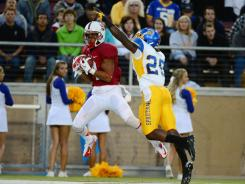 Stanford wide receiver Drew Terrell catches a touchdown pass in front of San Jose State cornerback Ronnie Yell during the first quarter Friday night.
