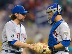 Mets catcher Josh Thole shakes pitcher R.A. Dickey's hand Friday after a shutout of the Marlins.