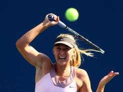 Maria Sharapova of Russia raps a forehand during her victory Friday against Mallory Burdette of the USA.