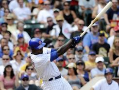 Cubs left fielder Alfonso Soriano hits an RBI single in the first inning of a 6-4 win Friday vs. the Giants.