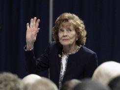 Sue Paterno, wife of former Penn State football coach Joe Paterno, waves to well-wishers as she enters a memorial service at Penn State's Bryce Jordan Center in State College, Pa., on Jan. 26. She is planning to attend Saturday's season opener.