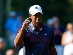 Tiger Woods acknowledges the cheers after a birdie on the 11th hole during the first round of the Deutsche Bank Championship at TPC Boston on Friday in Norton, Mass.