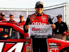 Tony Stewart reacts Friday after getting his first pole of the season.