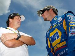 Martin Truex Jr., right, talks with team owner Michael Waltrip at Michigan International Speedway in mid-August.
