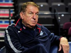USA Basketball chairman Jerry Colangelo watches a men's London Olympics warmup match vs. Great Britain on July 18 in Manchester, United Kingdom.
