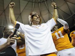 Tennessee coach Derek Dooley celebrates with his players after beating N.C. State on Friday night.