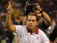 "Nick Saban and No. 2 Alabama routed No. 8 Michigan on Saturday. Said OL Barrett Jones: ""We're hungry and we're coming for another championship."""