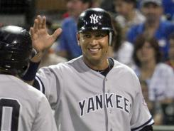 New York Yankees third baseman Alex Rodriguez, right, is congratulated on his run by teammate Ramon Flores during his rehab start for the Tampa Yankees in a minor league baseball game against the Lakeland Flying Tigers at Joker Marchant Stadium on Friday, Aug. 31, 2012, in Lakeland, Fla. Rodriguez made his first plate appearance since going on the disabled list on July 25 with a fractured left hand. (AP Photo/The Lakeland Ledger, Michael Wilson) TAMPA TRIBUNE OUT ORG XMIT: FLLAK103