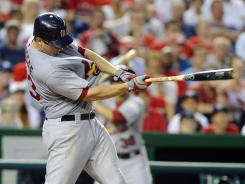 David Freese brings in the go-ahead run during the ninth inning for the Cardinals.