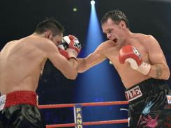 Daniel Geale, right, delivers a right hook to Felix Sturm during their unification title bout Saturday in Oberhausen, Germany.