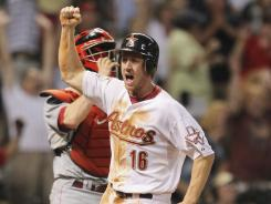 Matt Downs celebrates scoring the winning run in the Astros' victory over the Reds.