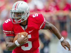 Ohio State Buckeyes quarterback Braxton Miller (5) carries the ball during the game against the Ohio Redhawks at Ohio Stadium.