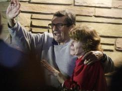 In this Nov. 9, 2011, file photo, former Penn State Coach Joe Paterno and his wife, Sue Paterno, stand on their porch to thank supporters gathered outside their home in State College, Pa.