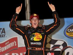 Ty Dillon celebrates his Camping World Truck Series win in victory lane Friday at Atlanta Motor Speedway.