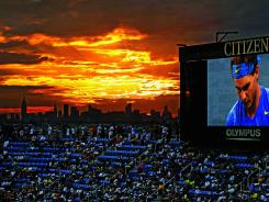 With the Manhattan skyline as a backdrop, fans at Arthur Ashe Stadium watch Rafael Nadal play Andy Murray in a semifinal match last year.