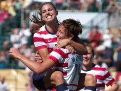 Alex Morgan jumps on Abby Wambach after Wambach's second goal.