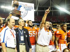 Clemson head coach Dabo Swinney celebrates after the Tigers topped No. 25 Auburn on Saturday night.