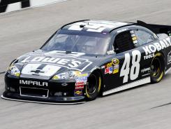 Jimmie Johnson takes a practice lap at Atlanta Motor Speedway, a track he and other drivers applaud, because, as he says, 'Every lap you make, the track gets more slick.'